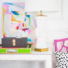 """The Carefully Curated Entryway-- it's your home's way of saying Have an Awesome Day and Welcome Back  // #SocietySocial designs that makes you smile: Raffia Pineapple Boxes, Faux Bamboo Trays, Geometric Lamps, Ostrich Nailhead Tables, Hot Pink #Rattan Chairs Paired with Spotted Pillows, Abstract Art """"Potty Mouth"""" by @susanskelley all in shop > www.shopsocietysocial.com!"""