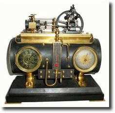 """C.1885, French """"Horizontal Steam Boiler"""" shelf clock from the Industrial Series of clocks. The boiler with engine, flywheel and governor. The 8-day time movement, barometer and thermometer, plus misc valves, tubes and fittings mounted on the front of the boiler."""