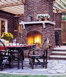 Outdoor double sided Brick fireplace on flagstone flooring Outdoor Fireplace Brick, Backyard Fireplace, Brick Fireplace Makeover, Fireplace Design, Brick Fireplaces, Outdoor Fireplaces, Fireplace Ideas, Flagstone Flooring, Patio Flooring