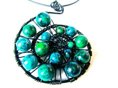 I like the blue and green swirl of the pendent.
