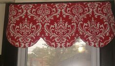 Lined Scallop valance.  White damask pattern on a red background.  Fully lined  Measures 42 inches wide x 16 inches high.  If you have a large