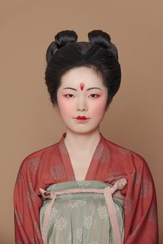 Asia | Portraiy of a young woman wearing traditional clothes and a Tang Dynasty style make-up, China