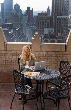 My kind of office...I like the view...but would need a better table and more comfy chair...lol