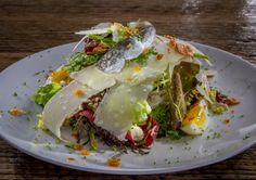Petite Lettuces salad w/egg, anchovy, herbs and parmesan at Mason Pacific in SF