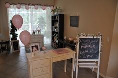 We transformed the whole house for the shower - the formal living room/entry way greeted guests and housed our Tea Party and Hot Chocolate bar... pink and white girl baby shower; tea party