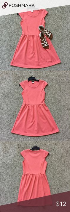 Pink/Coral Dress Very light and comfortable. Is in good, gently used condition. I think it is a large in juniors. I'm usually a small in adult sizes and this was big in me in the waist. Dresses