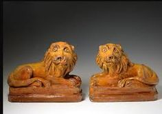 Pill Pottery lions, Earthenware c19th.