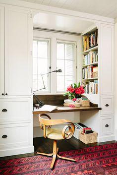 Idea for kitchen nook: desk under window with white built-in cabinets, bookshelf
