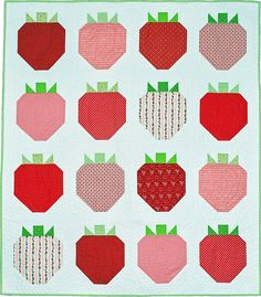 Nothing says summer quilts like strawberries! An assortment of red prints creates the big strawberry blocks for a throw quilt that's simply scrumptious!