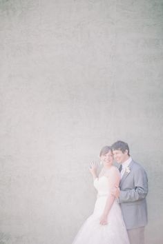 Vintage photos are most often light, airy and lovely.  We love this photo of Holly and Jeff in front of a soft grey wall.  You never know what can make an amazing backdrops! Photos by Clane Gessel Photography | #weddings #photography #seattleweddings