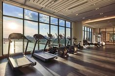 When designing a fitness center, it's important to choose the right type of flooring. Our recommendation? Rubber tiles! It will give any space a robust, yet stylish look!  #fitnesscenter #luxurygym #roomwithaview #commercialflooringsolutions