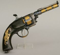 peashooter85:  A rare gold decorated transitional revolver crafted by Devisme of Paris circa 1860.