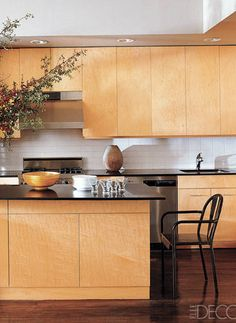 I love these modern blonde wood kitchen cabinets. From Elle Decor.