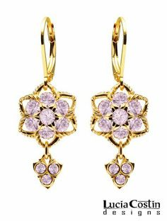 Flower Shaped Earrings by Lucia Costin with Lilac Swarovski Crystals and 6 Petal Flowers, Adorned with Twisted Lines and 3 Stones Dangle; 24K Yellow Gold Plated over .925 Sterling Silver Lucia Costin. $57.00. Dangle ornaments accented with floral design. Dangle earrings beautifully designed by Lucia Costin. Mesmerizing enough to wear on special occasions, but durable enough to be worn daily. Unique jewelry handmade in USA. Adorned with light purple Swarovski crystals