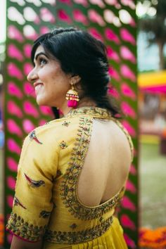 Bridal Blouses - Bride in a Backless Blouse with Parrot Embroider | WedMeGood #wedmegood #indianbride #indianwedding #backlessblouse #yellow #parrot #embroidery #indianblouse