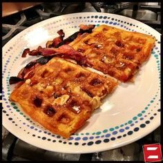 Ham and Cheese Waffles with maple syrup butter and bacon.