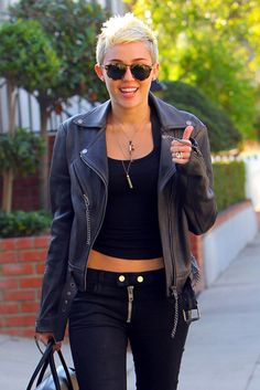 buzzed hair like pink the singer   Miley Cyrus looks punk rock in a leather jacket while talking a stroll ...
