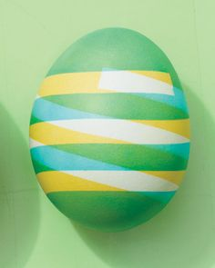 Peel off tape to reveal finished egg.     When finished, you can add a handwritten name with a permanent-ink pen to make a place card or a special gift to tuck into an Easter basket.