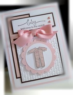 Adorable baby onesie card!  Pink satin bow and pink pearls really doll up this handmade baby card, made from mostly pink and white paper with powerful black trim.  Uses a scalloped-edge circle and lattice embossing.  Try it in blue!