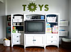 IHeart Organizing: Playroom    I'll do this in the family room. Take the doors off the entertainment center, put a book shelf on either side, and paint them all the same color.