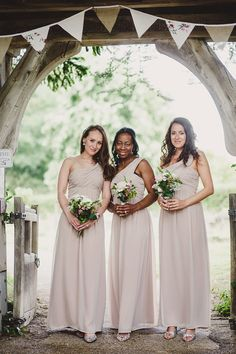 Bridesmaid wear floor length one shoulder nude dresses from Jane Norman at House of Fraser - Image by Lola Rose Photography - Pronovias 'Lary' wedding dress for a vintage inspired wedding in a country house with garden games, 1930s gramophone music & pink colour scheme