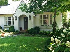 brick tudor cottage painted white -- before and afters