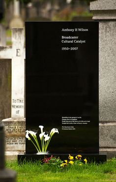 WOW - the headstone of Factory Records founder, Anthony Wilson. DEsigned by his longtime friend and a guy who made many of Factory's label graphics - Peter Saville