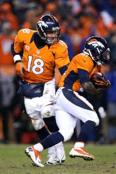 Peyton Manning #18 of the Denver Broncos hands the ball off to Ronnie Hillman against the Baltimore Ravens during the AFC Divisional Playoff Game