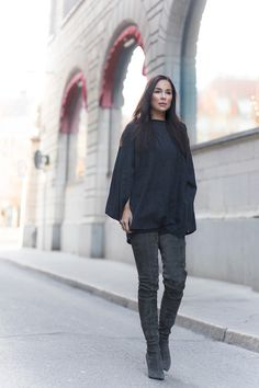 Ultra high boots are an absolute must have this season! Johanna Olsson wears this pair with a simplistic grey poncho from Zara, creating a sleek and attractive look which needn't cost you the bank! Poncho: Zara, Boots: Tamara Mellon.