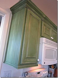10 ways to spruce up tired kitchen cabinets | nail holes and moldings