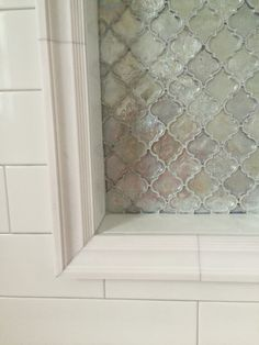Shower niche white subway tile, metallic arabesque tile, framed
