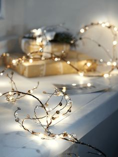 Adorned with festive jewels and sequins, this warm white LED garland is made up of super slim copper wires and paper branches. Use the copper wire to bend into any shape and display around your bannister, over your mantelpiece or transform into a light up jewelled wreath.