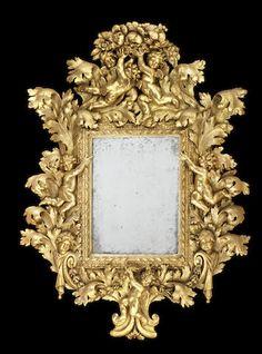 An impressive Italian late 17th century giltwood mirror