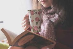 Finding the coziest reading spot, making a hot drink, and opening up to the first page.