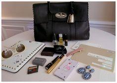Cosas que llevaría en mi bolso un día como mañana. Sobre todo fijaos en el IPad case de Valentino.