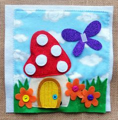 This little mushroom home is a pocket for a cute little bunny.  The dots on the roof are removable. And as in the other book, Fiona can fly to each page and attach to the wings shown above.