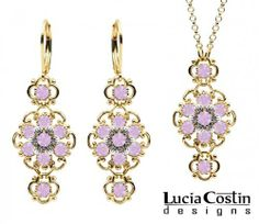 14K Yellow Gold over .925 Sterling Silver Pendant and Earrings Set Designed by Lucia Costin with Twisted Lines and Sterling Silver 6 Petal Flowers, Embellished with Dots and Lilac Swarovski Crystals Lucia Costin. $125.00. Floral jewelry set by Lucia Costin. Unique and feminine, perfect to wear for special occasions and evenings. Romantic floral design. Produced delicately by hand, made in USA. Adorned with light purple Swarovski crystals