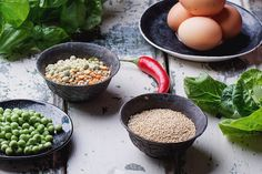 Quinoa Burger Ingredients - Quinoa Burger ingredients:  quinoa, mangold, dry grain mix, chili pepper, eggs green peas basil on white rustic board