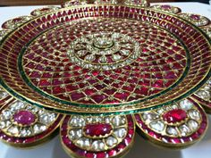 WOW. Just wow. Full size thali with uncut and rosecut burmese rubies and diamonds by Bhuramal Surana Jaipur
