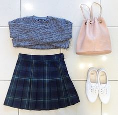 Plaid skirt and sweater, all from American Apparel.