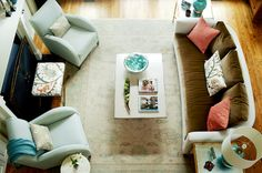 Kara Cox Interiors: Transitional living room with brown & turquoise blue wool rug, mink brown velvet sofa, ...