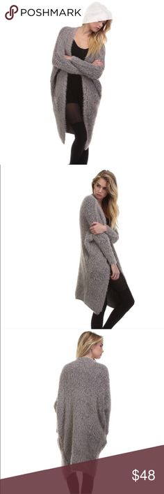 Silver Faux Fur Pocket Cardigan So soft and comfy! Gray faux fur pocket coat. 60% cotton/40% acrylic make us surprisingly lightweight and wonderful for layering. One size fits most. Tea n Cup Sweaters Cardigans