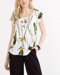 This Short Sleeve Printed Blouse is a must-have! Featuring a rounded neckline, it's styled with front buttons. Wear it with your favourite jeans for a casual look.<br /><br />Ready to wear for: the office, the weekend or a shopping spree