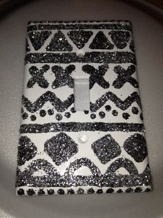DIY light switch cover. Just paint on design and add glitter!