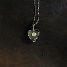 A beautiful recycled glass locket to put charms inside- including thumbprints of loved ones!