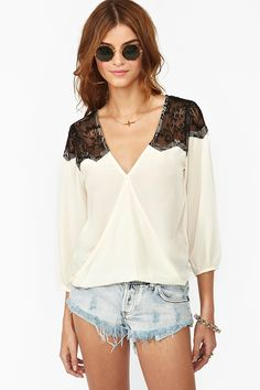 Love the contrast of the black lace shoulders on the off white. Pretty cut and style