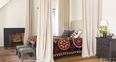 A vintage suzani covers the bed in a master bedroom.