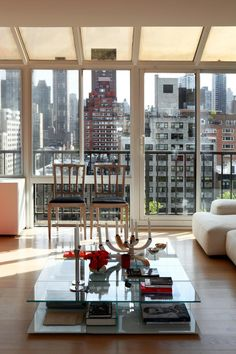Floor-to-ceiling windows, an open great room and modern geometric furniture all come together in this upscale New York City penthouse.