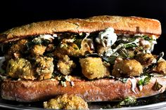 Taipei Oyster Po' Boy My jaw dropped when I saw the picture and heard the name.  That sounds like madness.  Droooolll