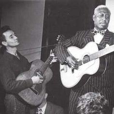 Masters of Americana:  Woody Guthrie and Leadbelly.